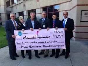 Left to right: Chuck Kramer, GM; Kristi Williams, Community Relations; Randall Reed, CEO of World Class Automotive present a check to Memorial Hermann Hospital.